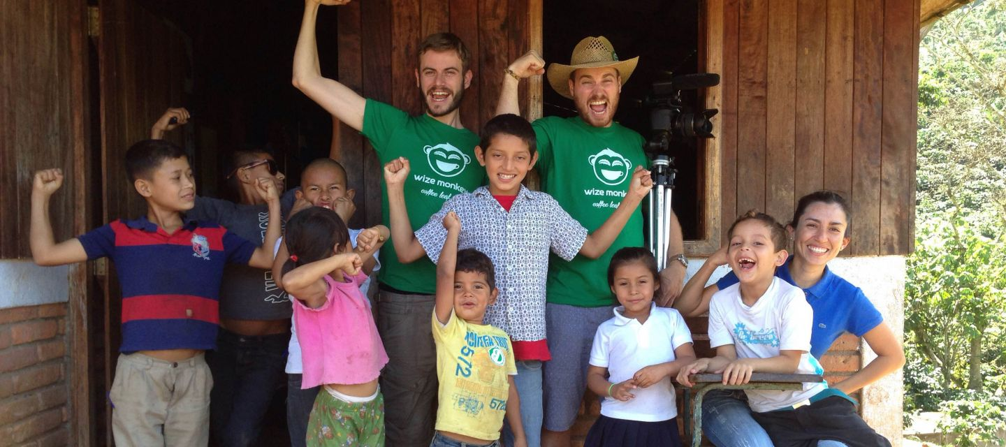 Wize Monkey co-founders are shown with the children of coffee growers in Matagalpa, Nicaragua.